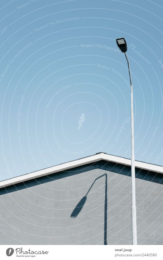 Buckling-Crack street lamp Cloudless sky House (Residential Structure) Wall (barrier) Wall (building) Facade Gable Simple Gloomy Blue Gray Boredom Loneliness