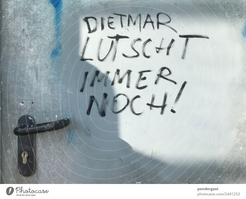 Dietmar lutscht immer noch! Pen Metal Signs and labeling Dirty Homosexual Funny Subdued colour Exterior shot Detail Deserted Central perspective
