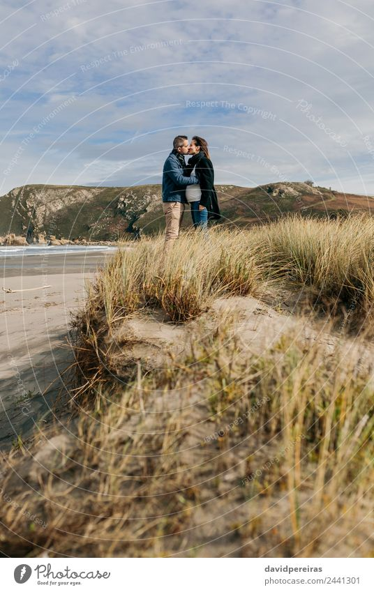 Couple kissing on the beach Woman Nature Man Landscape Ocean Calm Winter Beach Adults Lifestyle Autumn Love Coast Family & Relations Copy Space