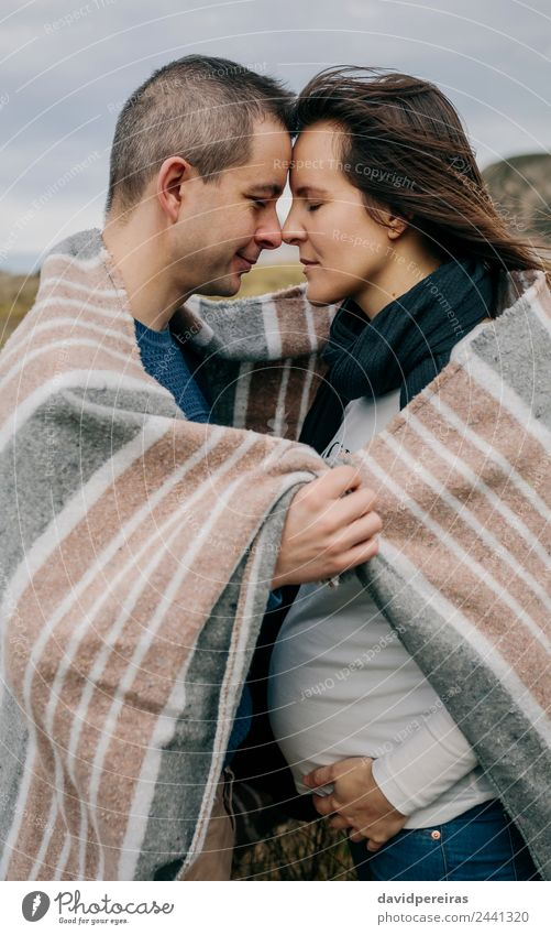 Pregnant with husband covered with a blanket Lifestyle Calm Winter Woman Adults Man Parents Family & Relations Couple Nature Landscape Clouds Autumn Grass Scarf