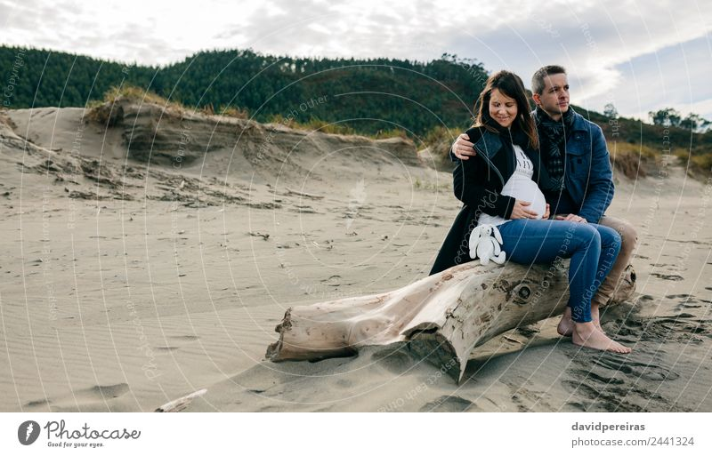 Pregnant on the beach with her partner Woman Human being Man Winter Beach Adults Lifestyle Autumn Love Happy Feet Couple Together Sand Sit Smiling