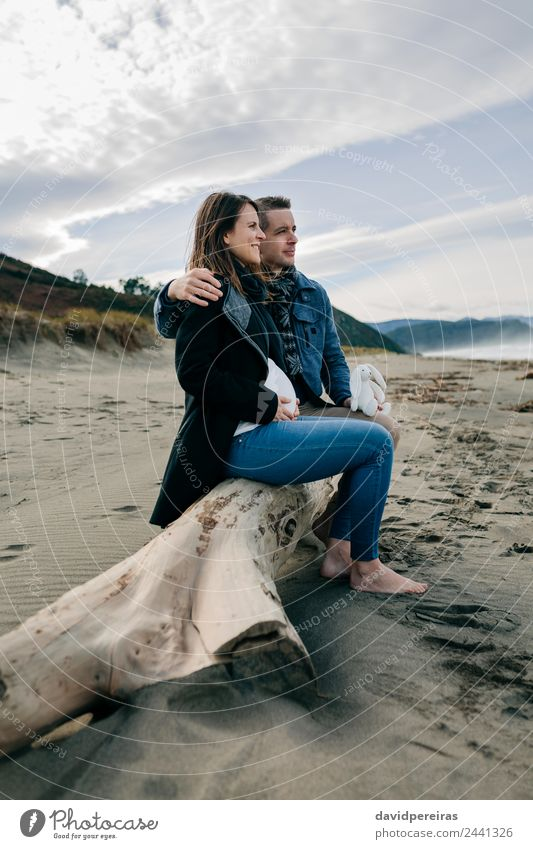 Pregnant on the beach with her partner Woman Human being Man Ocean Winter Beach Adults Lifestyle Autumn Love Happy Feet Couple Together Sand Sit