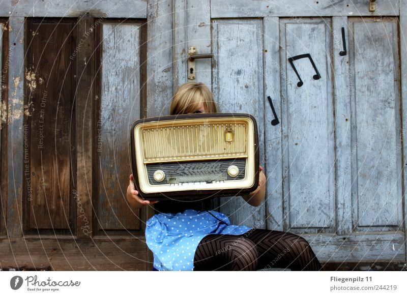 retro styled young woman poses with radio in front of old wooden gate. Music notes. tube radio Style Loudspeaker Radio (device) Young woman Youth (Young adults)