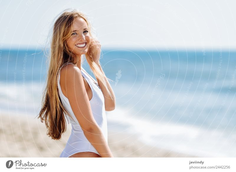 Young blonde woman in white swimsuit on the beach Beautiful Hair and hairstyles Leisure and hobbies Vacation & Travel Tourism Summer Beach Ocean Human being