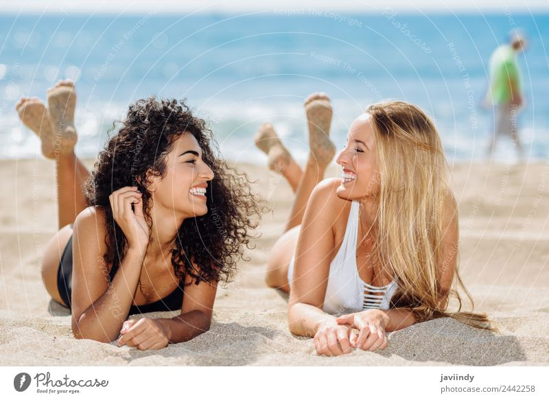 Two women lying on the sand on the beach Lifestyle Joy Hair and hairstyles Vacation & Travel Summer Beach Feminine Young woman Youth (Young adults) Woman Adults