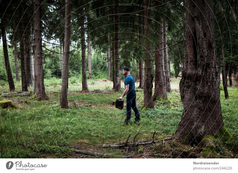 Man with a gas can in his hand is walking through a gloomy forest Vacation & Travel Adventure Summer Human being Adults 1 Nature Plant Forest Going Fear