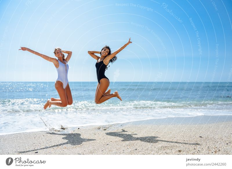 Two happy girls jumping on a tropical beach. Joy Vacation & Travel Tourism Summer Beach Ocean Human being Feminine Young woman Youth (Young adults) Woman Adults
