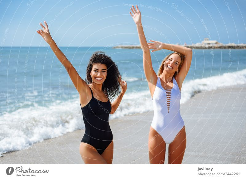 Two women in swimwear on a tropical beach. Joy Beautiful Body Vacation & Travel Tourism Summer Beach Ocean Human being Feminine Young woman Youth (Young adults)