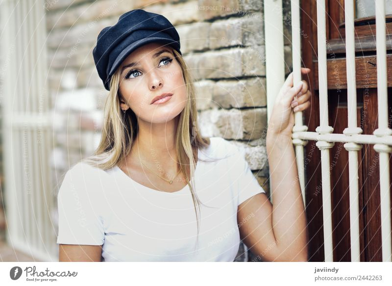 Young blonde woman standing near a brick wall. Lifestyle Style Beautiful Hair and hairstyles Summer Human being Feminine Young woman Youth (Young adults) Woman