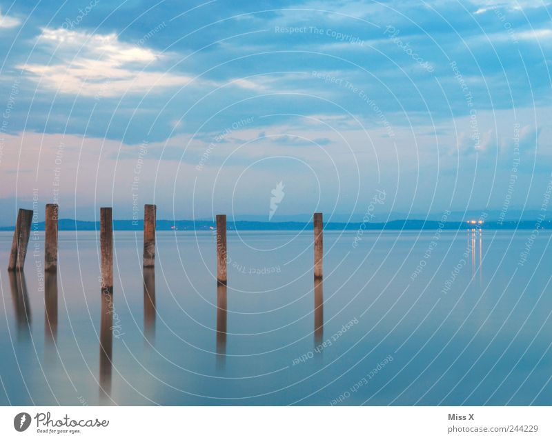 Water Sky Ocean Calm Lake Landscape Coast Idyll Lakeside Jetty River bank Wooden stake Water reflection Federal State of Burgenland