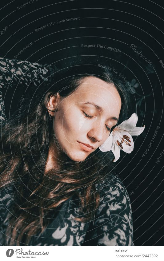 a girl with a white lily and closed eyes Lifestyle Beautiful Face Relaxation Calm Human being Feminine Young woman Youth (Young adults) Woman Adults 1