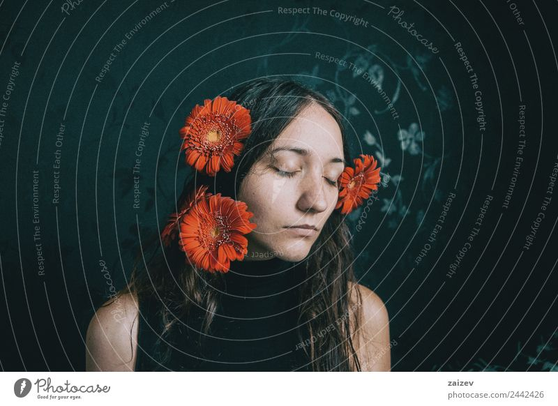 a girl covering herself with a gerbera flower Woman Human being Youth (Young adults) Young woman Plant Colour Beautiful Flower Relaxation Loneliness Calm Dark