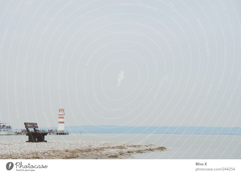 solitary Vacation & Travel Tourism Beach Environment Landscape Sand Weather Bad weather Fog Coast Lakeside Ocean Island Cold Park bench Lighthouse