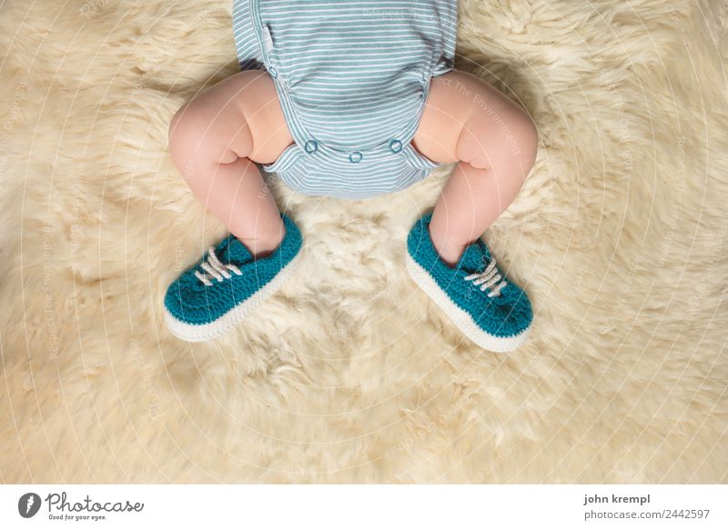 on a large foot Human being Masculine Baby Legs Feet 1 0 - 12 months rompers Footwear Slippers Sheepskin Lie Sleep Healthy Happy Positive Green Turquoise