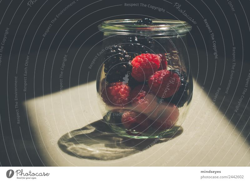 Forest berries in glass in sunlight Fruit Nutrition Glass Kitchen Blackberry Raspberry Preserving jar Eating To enjoy Growth Glittering Delicious Red