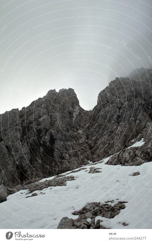 Mordor Elements Clouds Winter Bad weather Fog Snow Rock Alps Mountain Karwendelgebirge Chalk alps snowfield Hiking Dark Sharp-edged Cold Gray Vacation & Travel