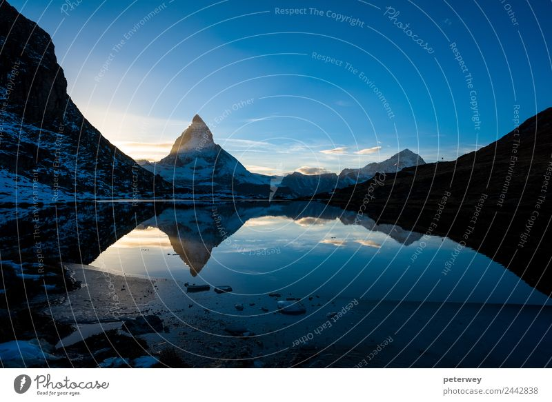 Matterhorn and Dente Blanche from Riffelsee mountain lake Trip Freedom Mountain Hiking Nature Sky Sunrise Sunset Alps Lake Blue Yellow Black Beautiful
