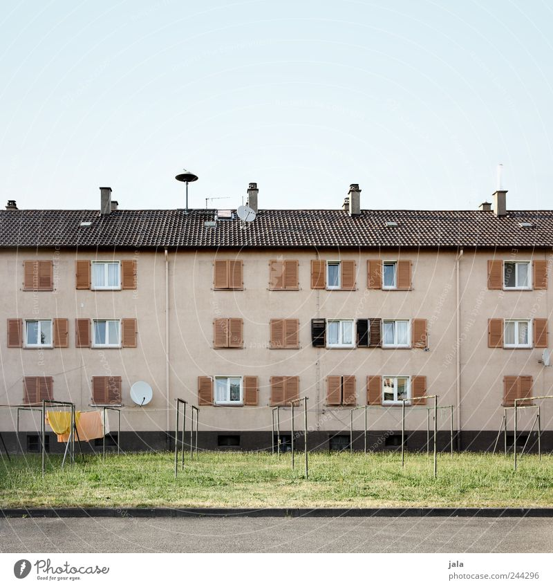 Sky City House (Residential Structure) Meadow Wall (building) Window Grass Wall (barrier) Building Facade Places Gloomy Roof Manmade structures Chimney Antenna
