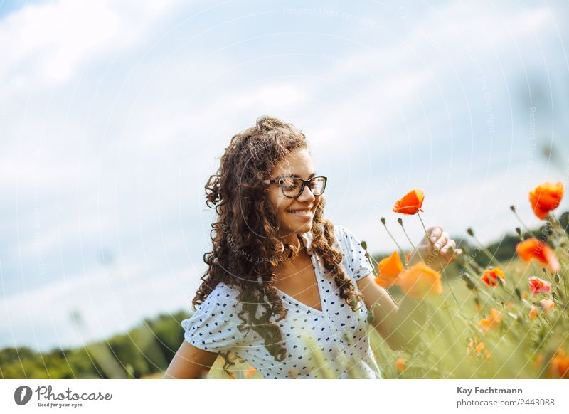 Young pretty woman picks a poppy flower Lifestyle Joy Happy Wellness Harmonious Well-being Contentment Senses Relaxation Vacation & Travel Tourism Trip Freedom