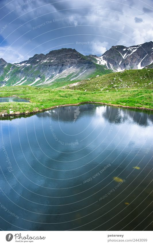 Small mountain lake in Greina valley, Ticino, Switzerland Tourism Trip Nature Storm clouds Mountain Lake Hiking Blue Gray Green Alpine alps grass greina high