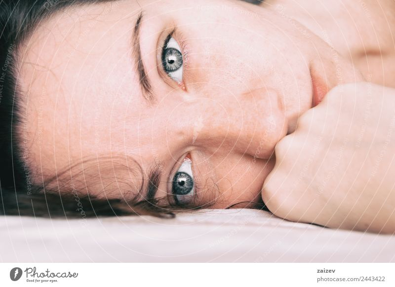 a girl with big blue eyes looking at the camera Woman Human being Youth (Young adults) Young woman Colour Beautiful White Relaxation Loneliness Calm Girl