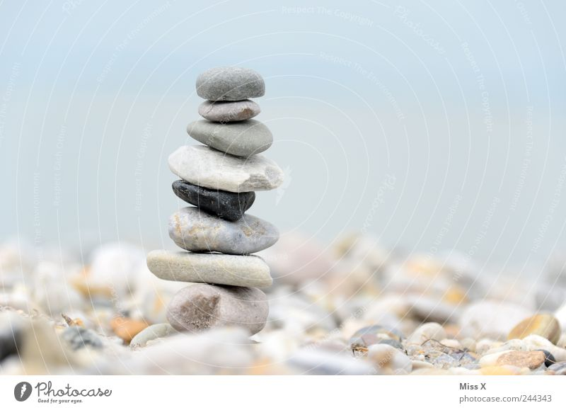 stonemen Stone Contentment Stack Cairn Heap Tower Pebble Beach Coast Gray Balance Point Build Colour photo Subdued colour Exterior shot Close-up