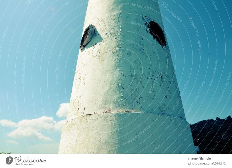 round and thick Lighthouse Tower Concrete Round Building Blue White windowless Ocean
