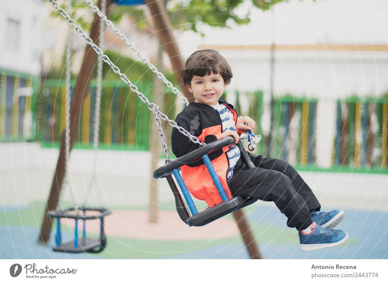 Playing kid Joy Happy Leisure and hobbies Child School Boy (child) Infancy Youth (Young adults) Park Playground Sweater Tights Brunette Metal Movement Smiling