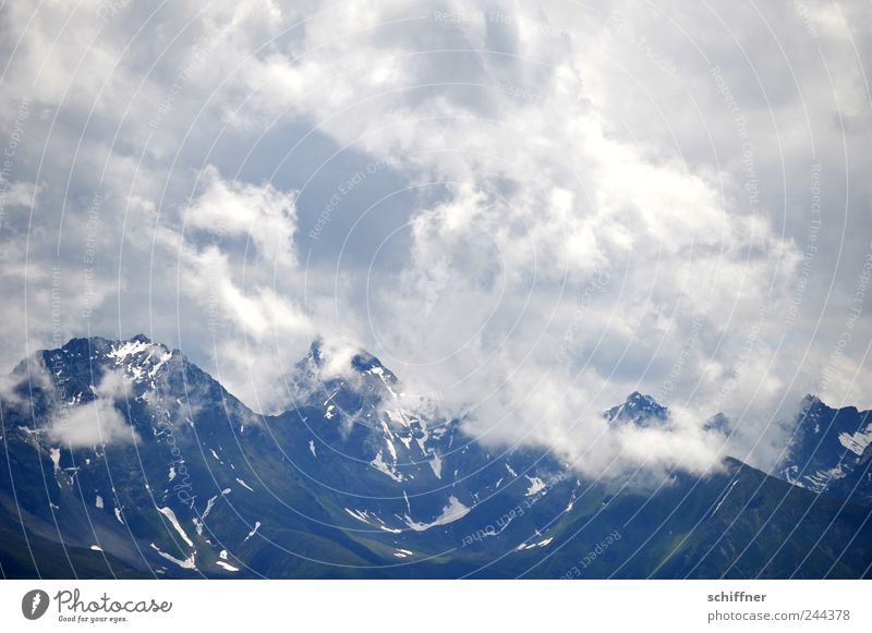 whipping cream Landscape Clouds Storm clouds Summer Weather Bad weather Rain Thunder and lightning Rock Alps Mountain Peak Snowcapped peak Glacier Esthetic