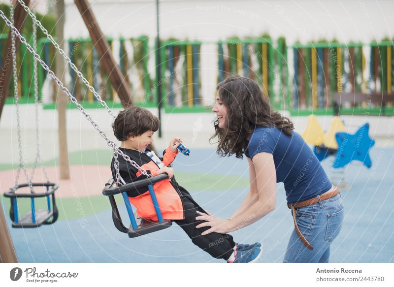 Playing outdoors Joy Happy Leisure and hobbies Child School Boy (child) Woman Adults Parents Mother Infancy Youth (Young adults) Park Playground Sweater Tights