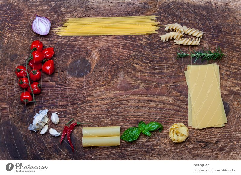 Frame of pasta and ingredients Cheese Vegetable Herbs and spices Vegetarian diet Decoration Table Leaf Wood Fresh Noodles Spaghetti spirelli Eating boil