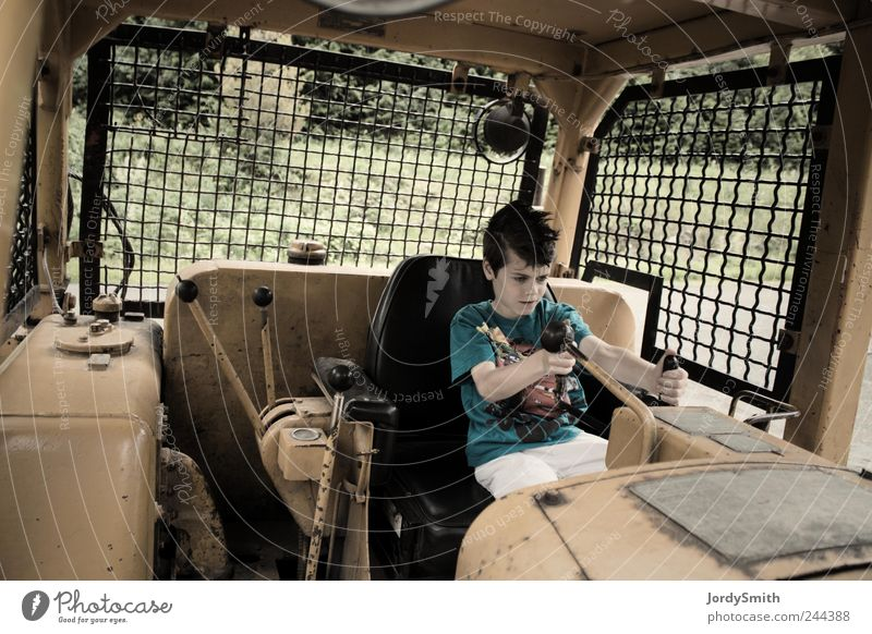 The Boy in the Mighty Machine Machinery Construction machinery Human being Child Boy (child) 1 8 - 13 years Infancy Vehicle Construction vehicle Sit Playing