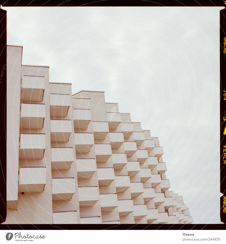 500 Architecture Building Hotel bedtenburg Facade Balcony White Grid Structures and shapes Arrangement Row Sky Covered Clouds Copy Space Deserted