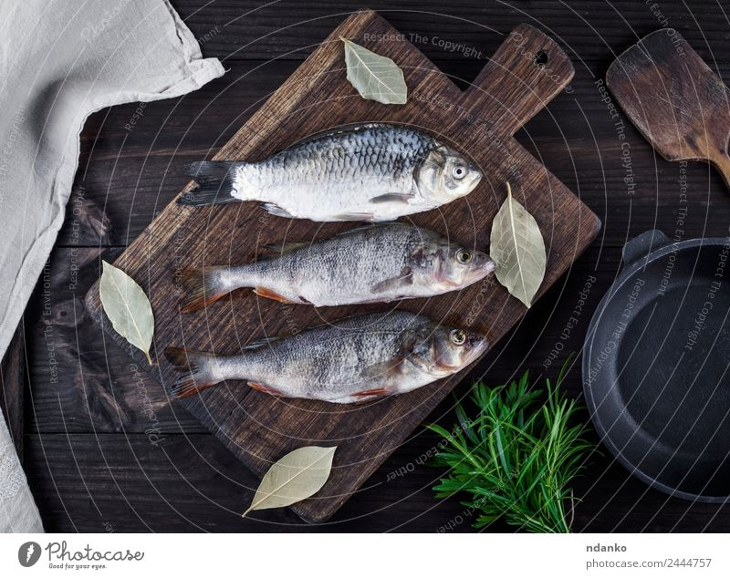 river fish crucian and perch Fish Seafood Herbs and spices Nutrition Dinner Diet Pan Table Animal River Wood Dark Fresh Above Retro Brown Black Perches