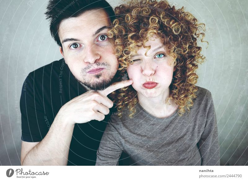 Young couple posing with funny faces Lifestyle Joy Human being Masculine Feminine Woman Adults Man Family & Relations Friendship Couple Partner