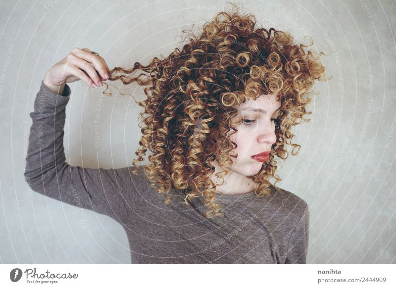 Young disappointed woman touching her hair Lifestyle Style Beautiful Hair and hairstyles Senses Hairdresser Human being Feminine Young woman
