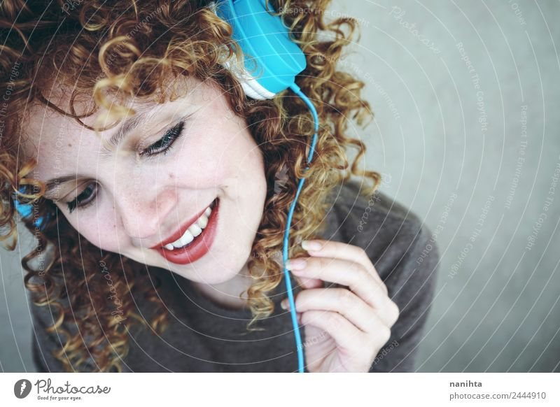 Blonde woman listening to music with her headphones Lifestyle Style Joy Beautiful Hair and hairstyles Skin Face Wellness Well-being Leisure and hobbies Headset