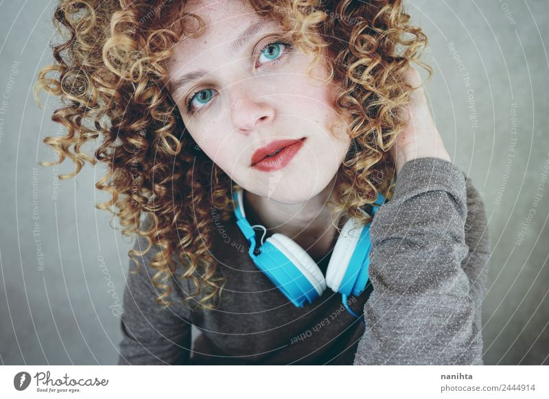 Young blonde woman with blue eyes with a headset Lifestyle Style Beautiful Hair and hairstyles Skin Face Leisure and hobbies Headset Technology