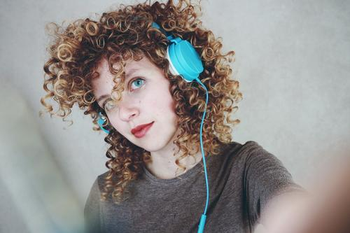 Young blonde woman listening to music with her headphones Lifestyle Style Beautiful Hair and hairstyles Leisure and hobbies Headset Headphones Technology