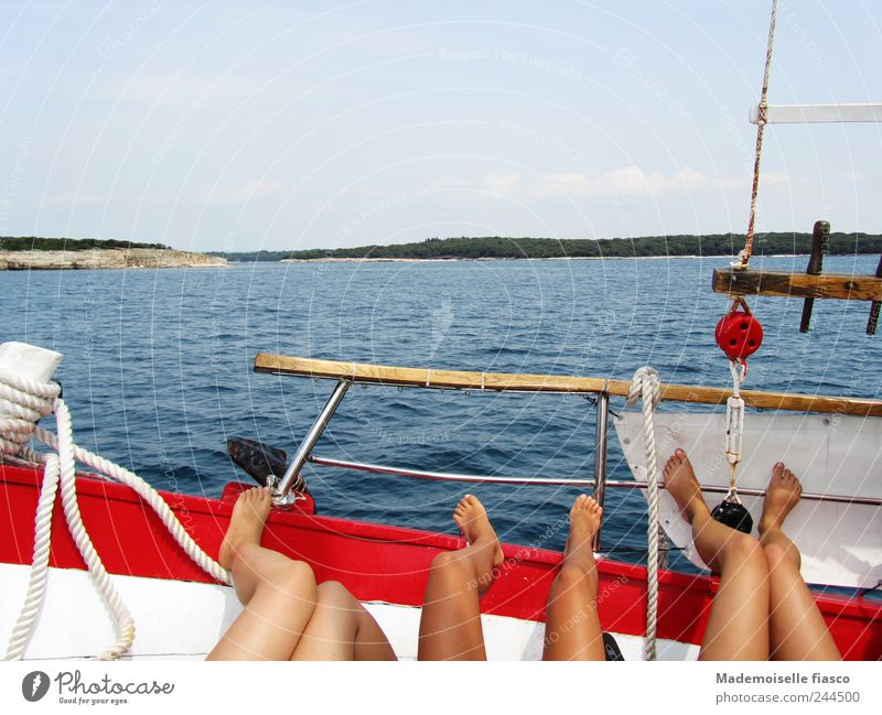 Legs while sunbathing on floating/driving boat near coast Relaxation Trip Ocean Young woman Youth (Young adults) 3 Human being 18 - 30 years Adults Boating trip