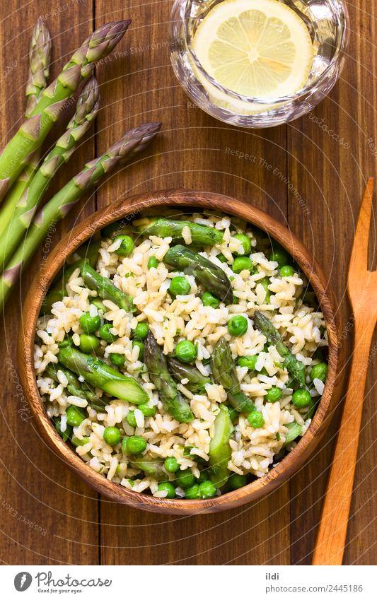 Asparagus Pea and Brown Rice Risotto Dish Natural Nutrition Fresh Vegetable Grain European Meal Vegetarian diet Vertical Rustic Peas Italian Parsley