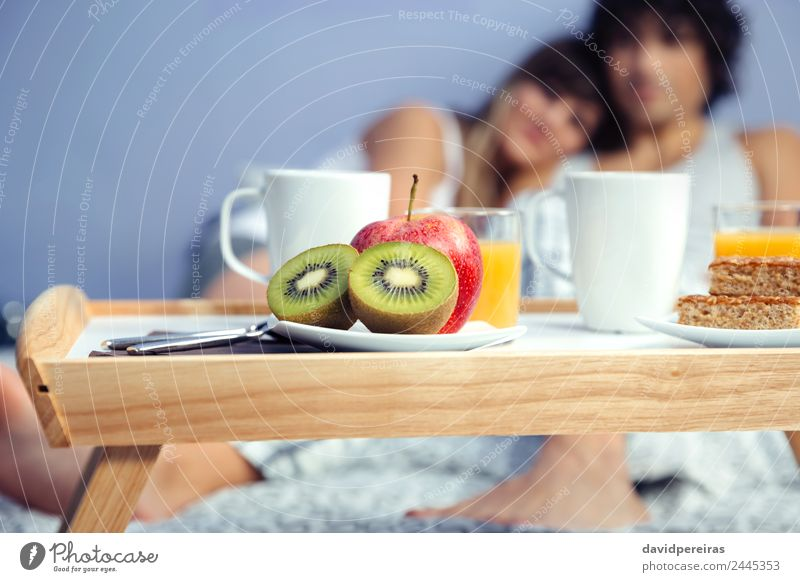 Pieces of fruit in healthy breakfast served on tray Woman Man Beautiful Relaxation Adults Lifestyle Love Happy Couple Together Leisure and hobbies Fruit Smiling