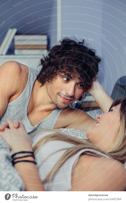 Man looking to beautiful woman lying on bed Lifestyle Happy Beautiful Relaxation Bedroom Woman Adults Family & Relations Couple Smiling Love Sleep Sex Authentic