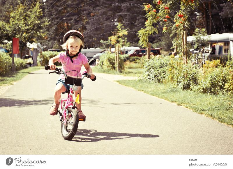 Human being Child Girl Summer Environment Lanes & trails Small Infancy Blonde Bicycle Study Childhood memory Safety Cute Driving Target