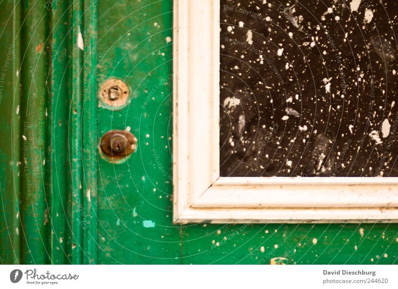 Details of a door Door Green White Closed Old Rustic Window Window pane Molding Dirty Line Colour Varnished Keyhole Colour photo Exterior shot Close-up