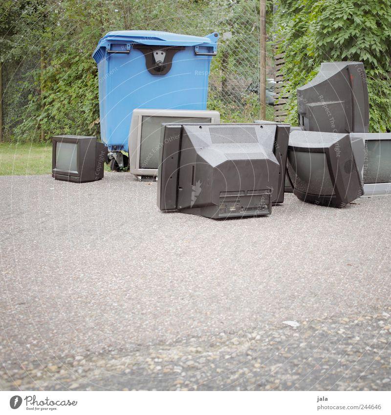 tv week TV set Plant Grass Bushes Meadow Places Trash container Waste management Scrap metal Electrical equipment Broken Colour photo Exterior shot Deserted