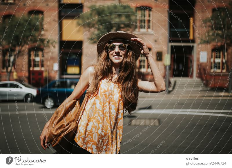 Blonde thin woman with hat and sunglasses visiting the city during the day. Lifestyle Style Joy Beautiful Body Leisure and hobbies Vacation & Travel City trip