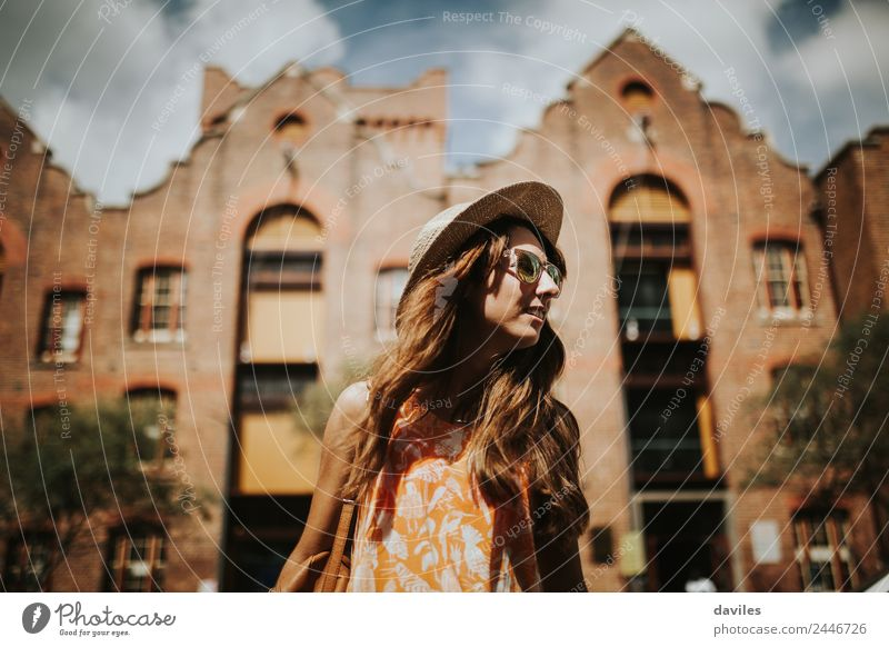 Cute woman looking away in the street Woman Human being Vacation & Travel Youth (Young adults) Young woman Summer Town Beautiful 18 - 30 years Street Adults