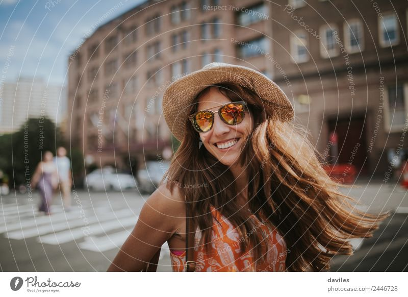 Long hair girl with hat and sunglasses walking in Sydney city streets in Australia. Lifestyle Leisure and hobbies Vacation & Travel Tourism Trip Human being
