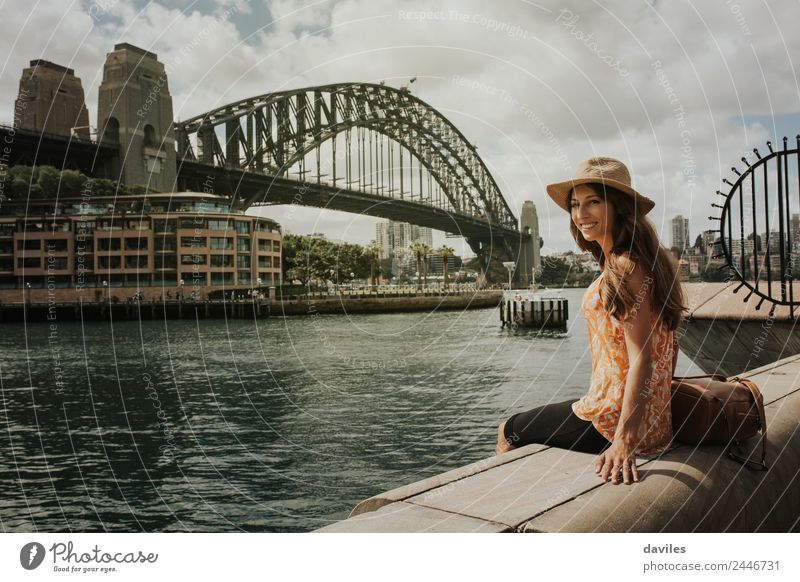 Happy woman looking at camera with Harbor Bridge in the background, in Sydney city, Australia. Lifestyle Joy Wellness Leisure and hobbies Vacation & Travel Trip